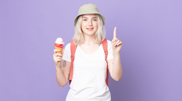 Young pretty albino woman smiling and looking friendly, showing number one .summer concept