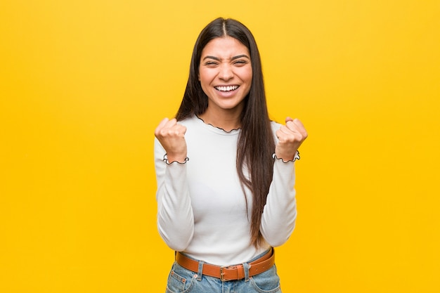 Young pretty arab woman on yellow cheering carefree and excited. victory concept.