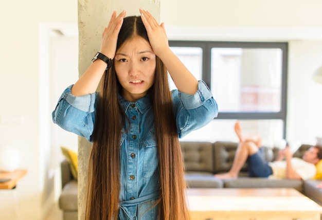 Young pretty asian woman feeling frustrated and annoyed, sick and tired of failure, fed-up with dull, boring tasks