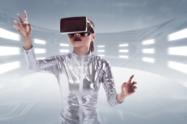 Young pretty asian woman wearing vr headset inside virtual world
