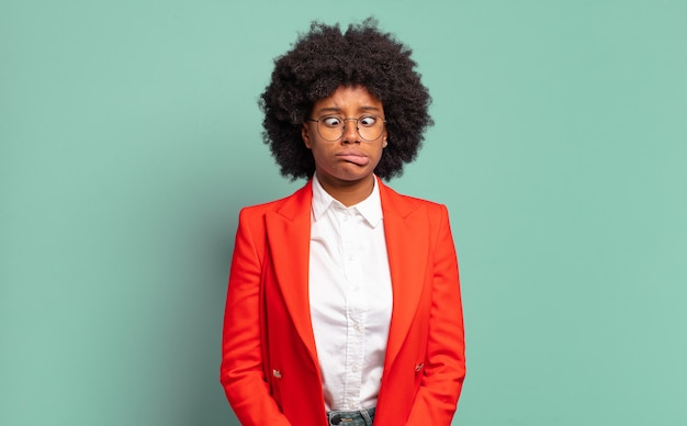 Young pretty black businesswoman making funny faces