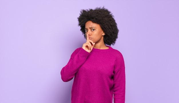 Young pretty black woman shushing