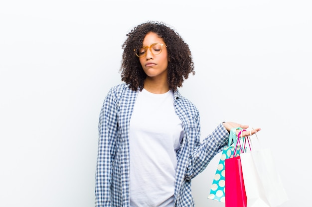 Young pretty black woman with shopping bags