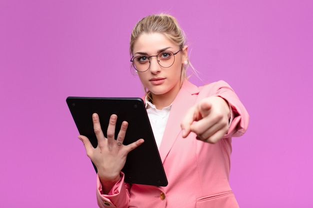 Young pretty blonde woman using a tablet