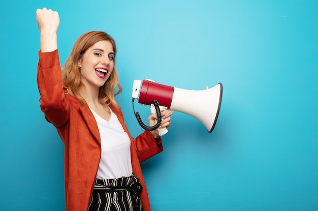 Young pretty blonde woman with a megaphone
