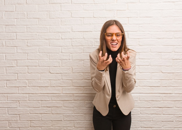 Young pretty business entrepreneur woman angry and upset