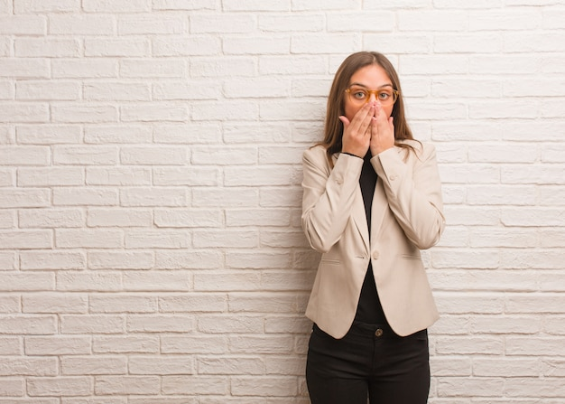 Young pretty business entrepreneur woman surprised and shocked