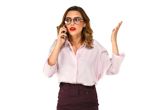 Young pretty business woman talking on the mobile phone, looks confused