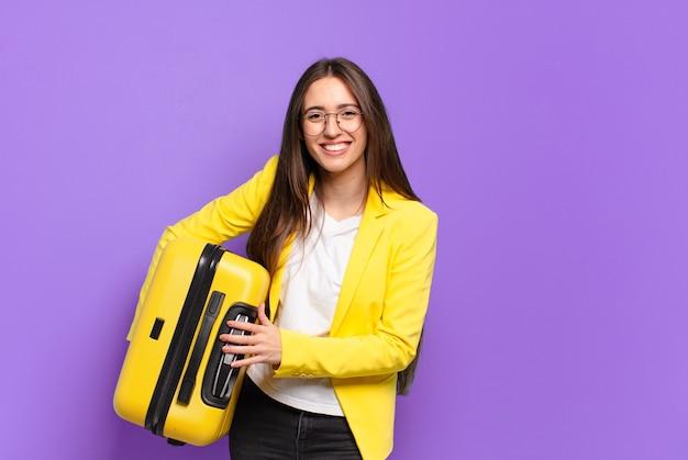 スーツケースを持つ若いかわいい実業家