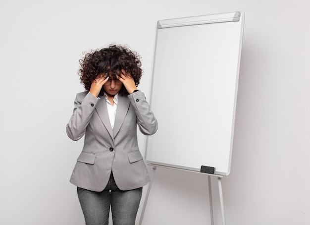 Young pretty businesswoman with white board