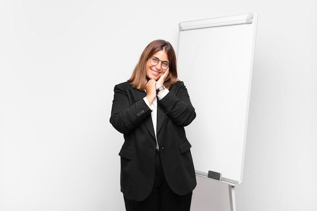 Young pretty businesswoman with a white board