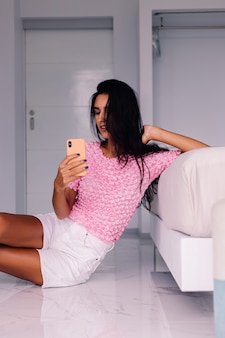 Young pretty caucasian woman fashion blogger wearing stylish clothes, taking photo selfie