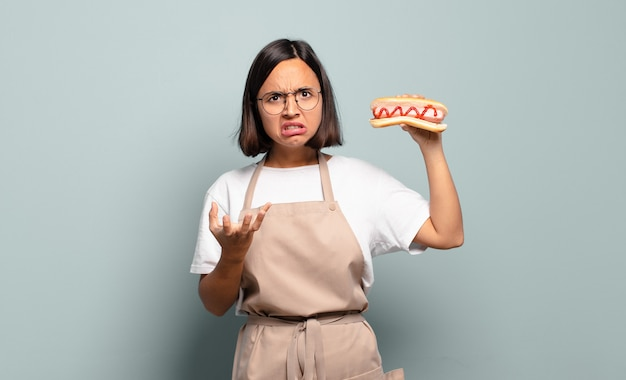 Young pretty chef woman. fast food concept
