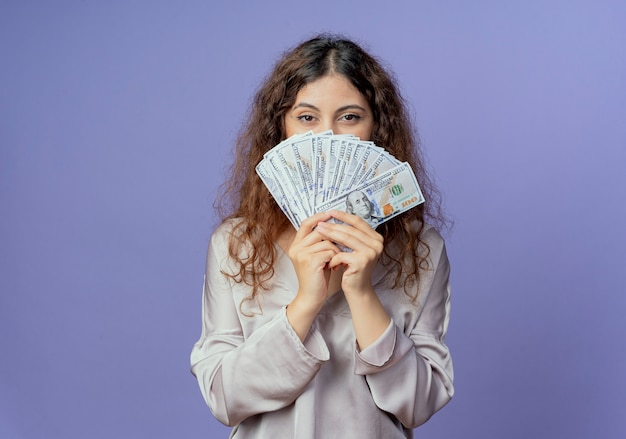 Young pretty girl covered face with money