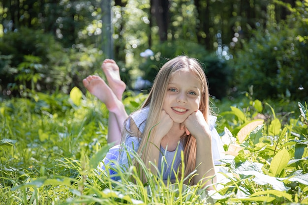 Young pretty girl laying on the grass