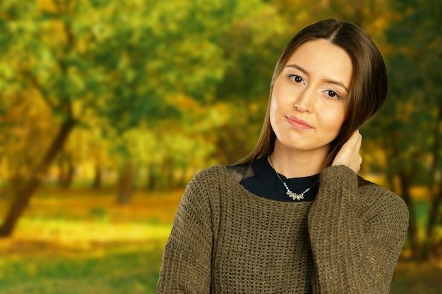 Young pretty girl portrait in autumn park