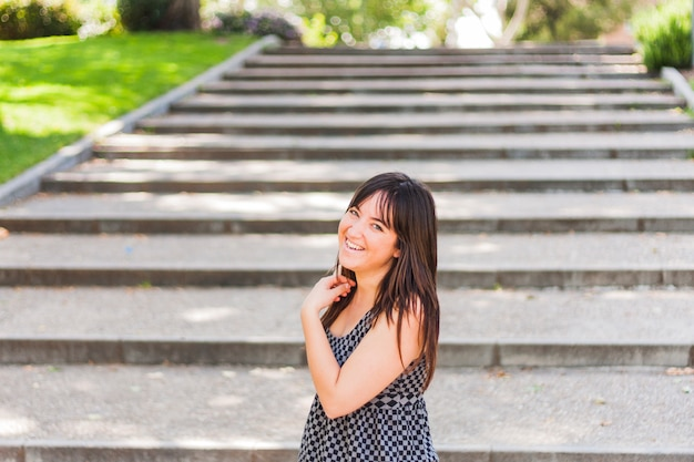 Young pretty girl smiling on stairs