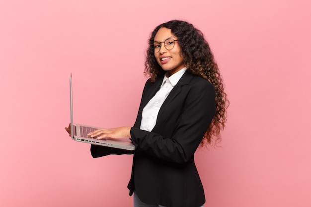 Young pretty hispanic businesswoman with a laptop