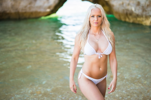 Young pretty woman in bikini on sea background