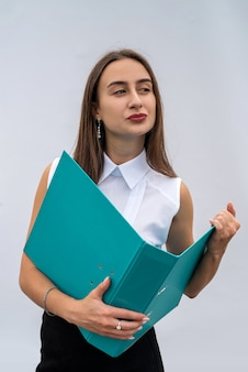 Young pretty woman in business clothes with paper folder, isolated on white background. concept of job