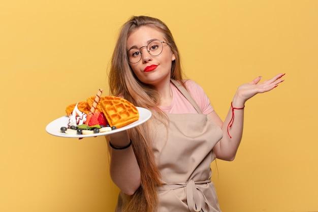 若いきれいな女性の混乱した表現のパン屋の概念