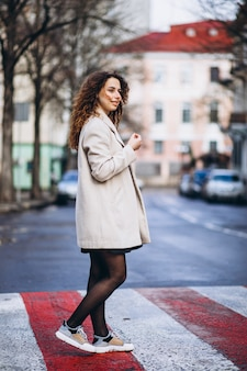 Young pretty woman on a crosswalk