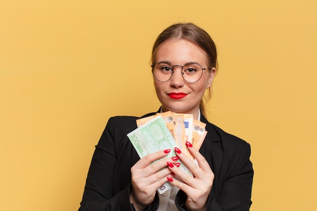 Young pretty woman. happy and surprised expression. euro banknotes concept