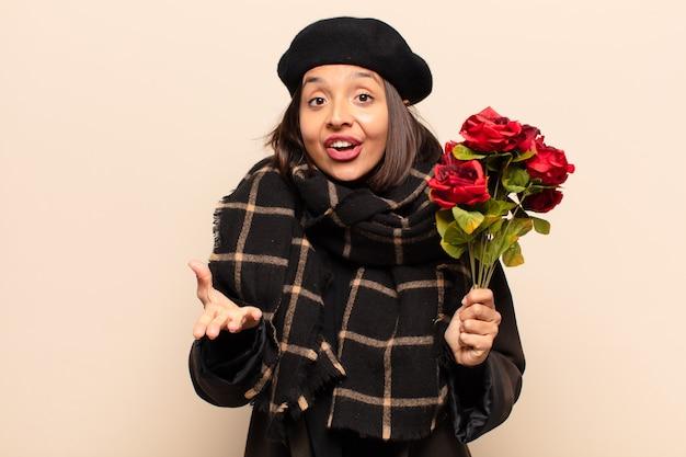 バラの花束を持っている若いきれいな女