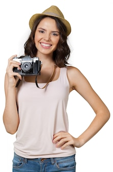 Young pretty woman holding camera