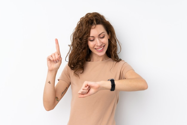 Young pretty woman looking at the hand watch