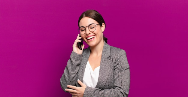 Young pretty woman showing her empty screen telephone. businessconcept