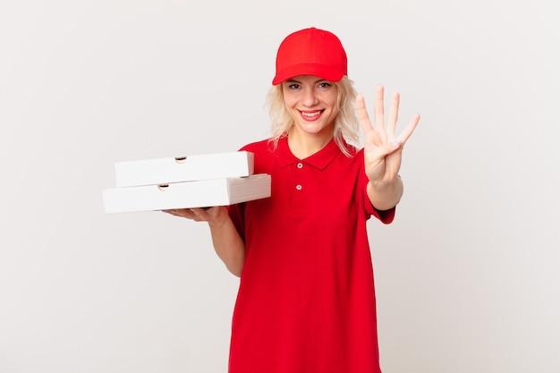 Молодая красивая женщина улыбается и выглядит дружелюбно, показывая номер четыре. концепция доставки пиццы