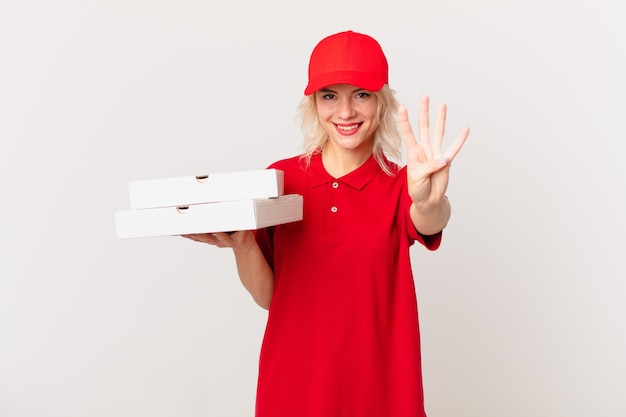 Young pretty woman smiling and looking friendly, showing number four. pizza delivering concept