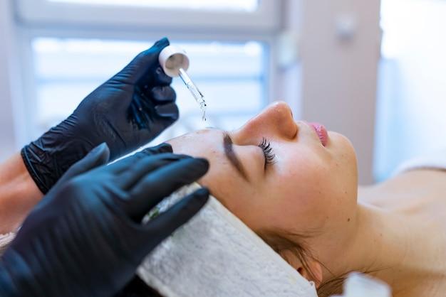 Young pretty woman takes spa treatments. close portrait