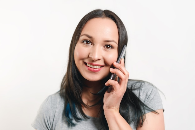 Young pretty woman talking on the phone and smiling