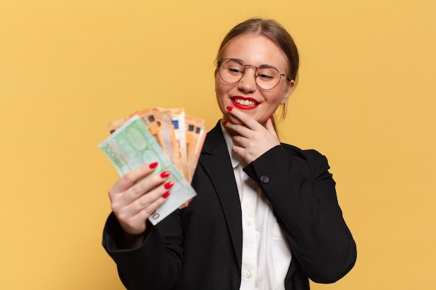 Young pretty woman. thinking or doubting expression euro banknotes concept