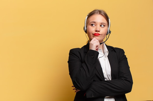 Young pretty woman. thinking or doubting expression telemarketer concept