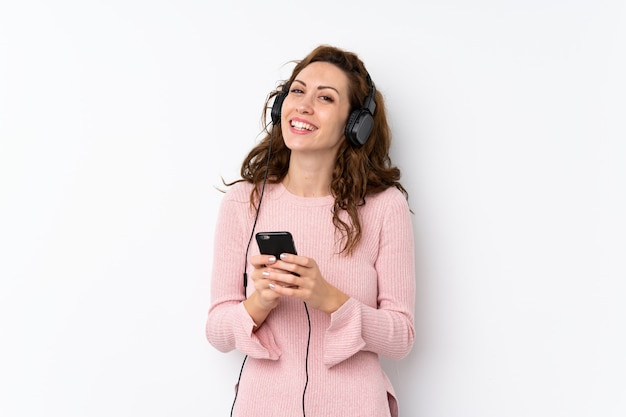 Young pretty woman using the mobile with headphones