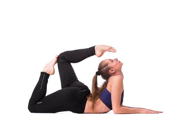 Young pretty woman in white active wear make yoga exercises on white background