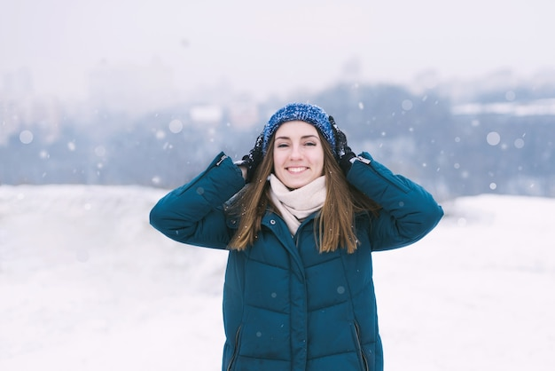Young pretty woman in winter clothes smiling.