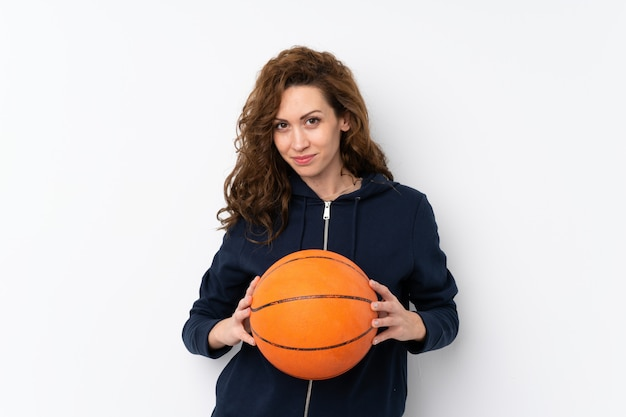 Young pretty woman with ball of basketball