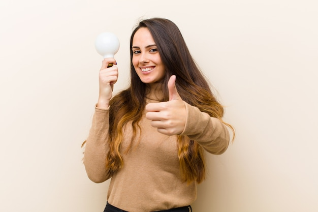 Young pretty woman with  bulb, having an idea