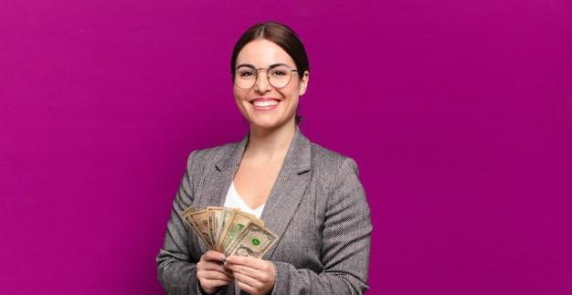 달러 지폐와 젊은 예쁜 여자 프리미엄 사진
