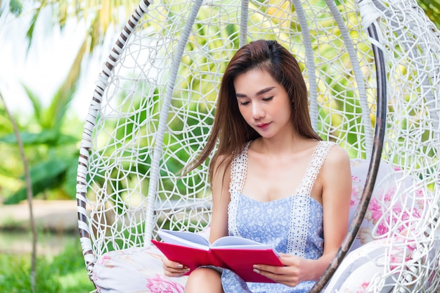 Young pretty woman with red diary in park