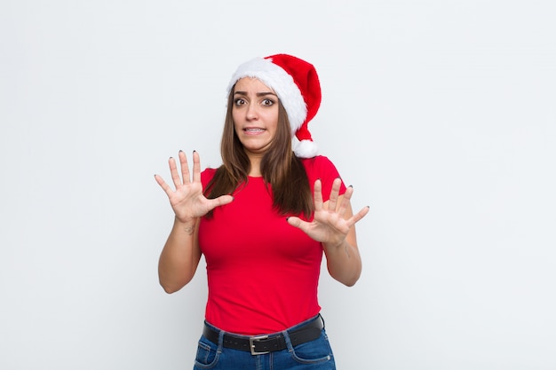Young pretty woman with santa hat. christmas concept.