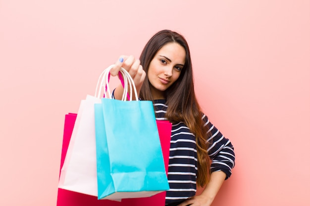 Young pretty woman with shopping bags