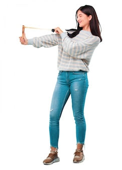 Young pretty woman with a slingshot