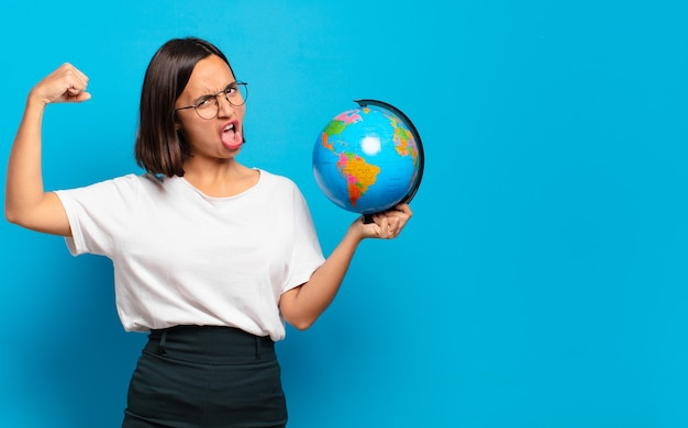 Young pretty woman with a world globe map