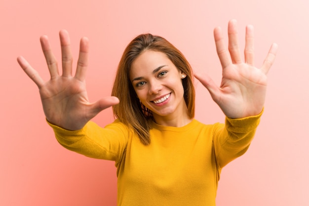 Young pretty young woman showing number ten with hands.