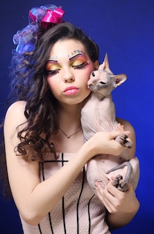 Young princess with sphynx cat